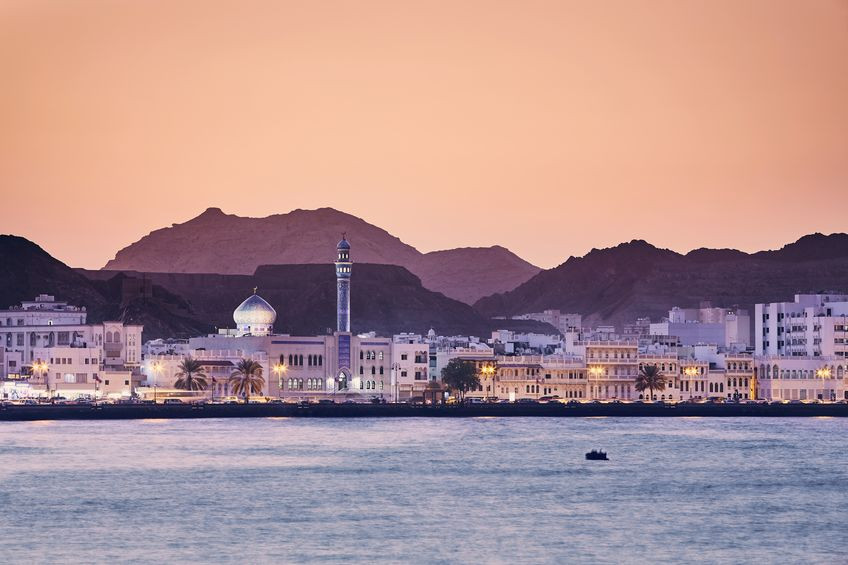 Cityscape view of Muscat city at golden sunset - the capital of Oman.