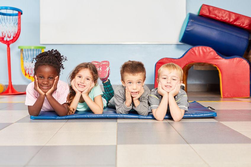 Little kids in kindergarten playing