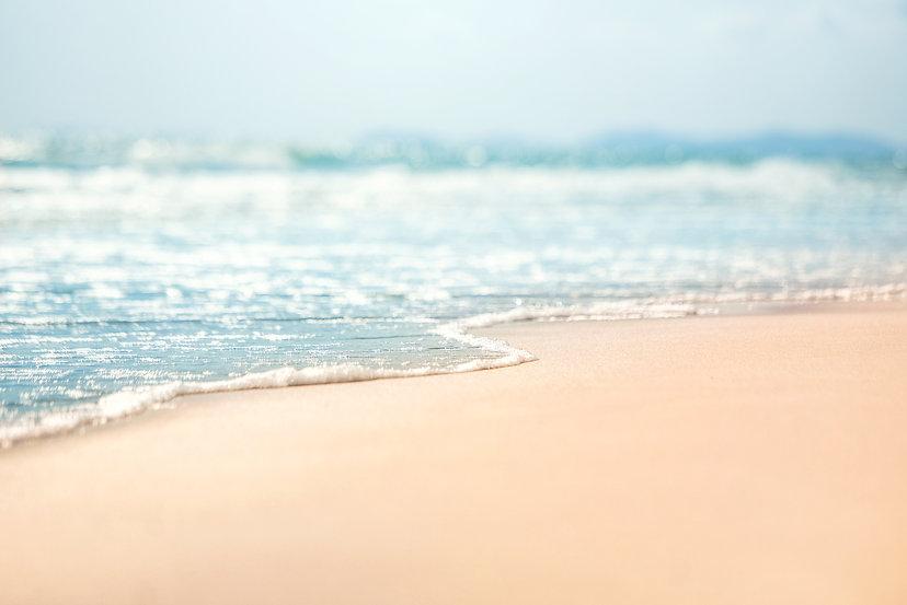 close-up-soft-wave-sea-sandy-beach.jpg