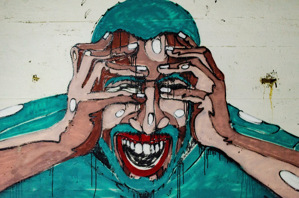 Grafitti Art Man Holding Face Stressed Out