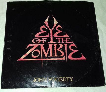 "John Fogerty - Eye Of The Zombie (7"", Single) (Warner Bros. Records)"