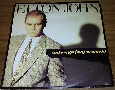 "Elton John - Sad Songs (Say So Much) (7"", Single, Sil) (The Rocket Record Compa"