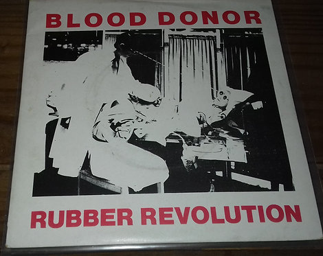 """Blood Donor - Rubber Revolution (7"""", Single, Red) (Arista)"""