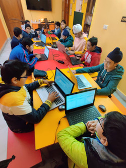 Young Primary Students Coding in Tandem