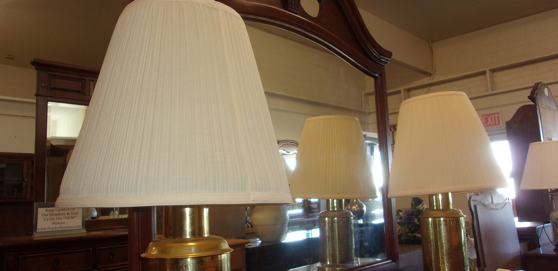 Lamps on tall mirrored dresser