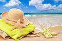 12128406-Beach-bag-with-towel-and-sun-ha