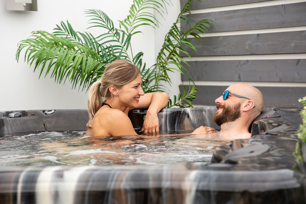 Couple in hot tub having deep conversation