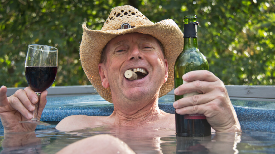 Man in hot tub drinking wine