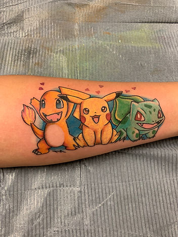 Tattoo of Pikachu, Squirtle, and Bulbasaur from Pokèmon by Jeremy Keith at DreamHouse Tattoo in Boulder, CO.