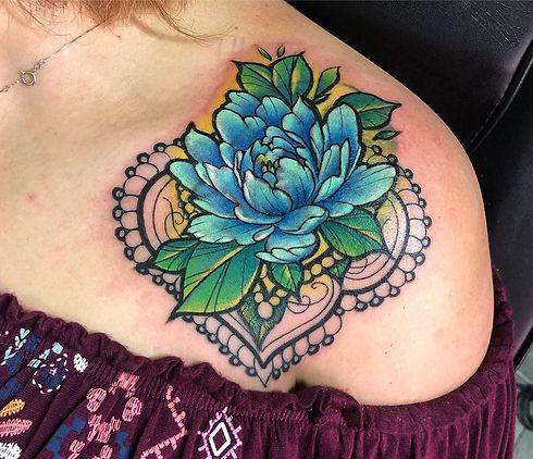 Flower tattoo and mandala tattoo by tattoo artist Eli Maldonado at DreamHouse Tattoo Shop in Boulder, CO