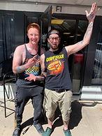 Tattoo artist Jordan Lucky with a client at DreamHouse Tattoo shop in Boulder, CO.