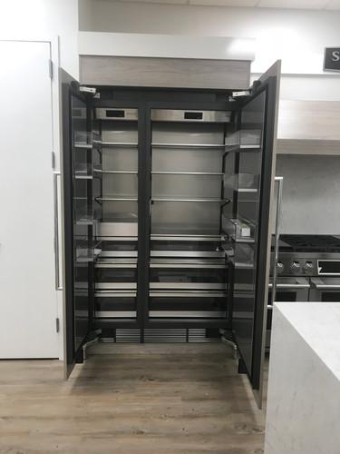 "48"" fridge with custom panels installed"