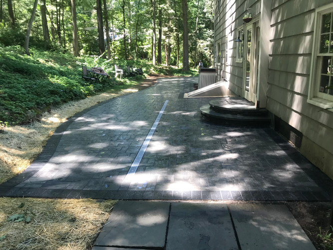 73' long patio with very tough slope challenges
