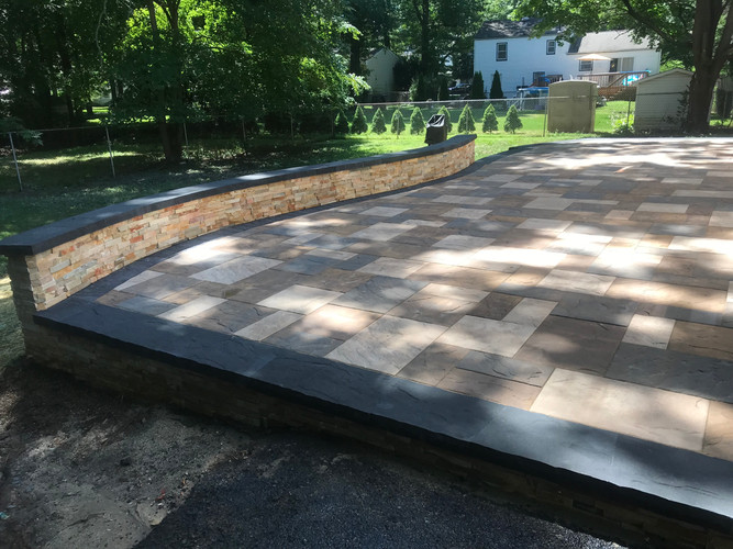 Free form patio with seating wall