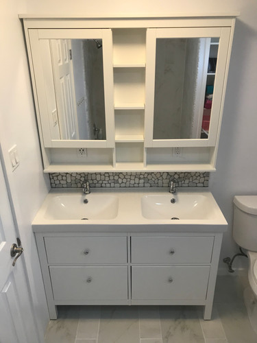 Double sink with custom tiled backsplash