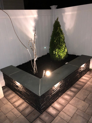 Outdoor seating wall with lights