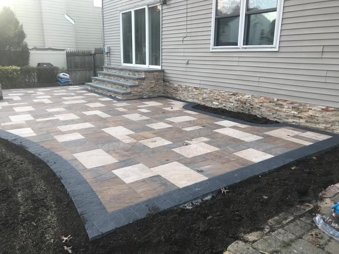 Concrete patio with stone veneer accents