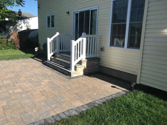 New custom steps with vinyl railings installed