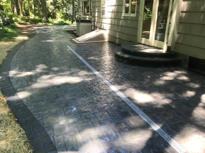 Concrete paver patio with built in drain