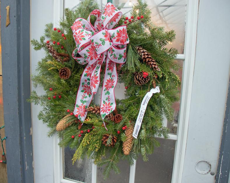 christmas wreath  pointsetta ribbon pine