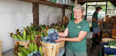 heather packing farm share baskets.jpg