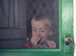 girl behind screen door