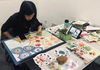 Student Amber Chao in class working on her portfolio artwork.
