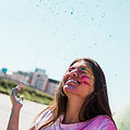 blue-holi-powder-smiling-young-woman-out