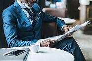 black news blue suit.jpg