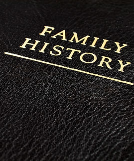 A Black Leather Bound Book Cover that Reads _Family History_.jpg