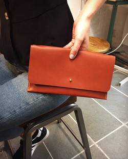 The finished Clutch with contrasting yellow waxed linen thread_