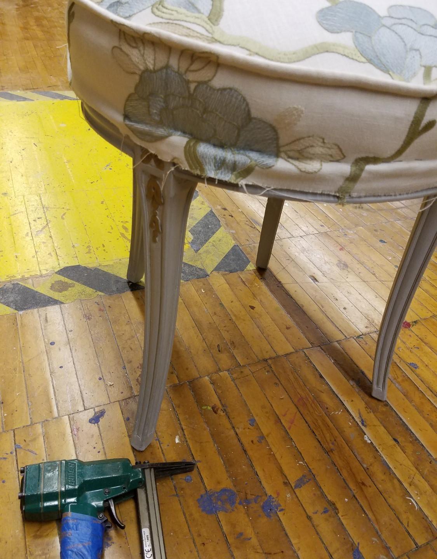Adding tacks to new fabric seat cove
