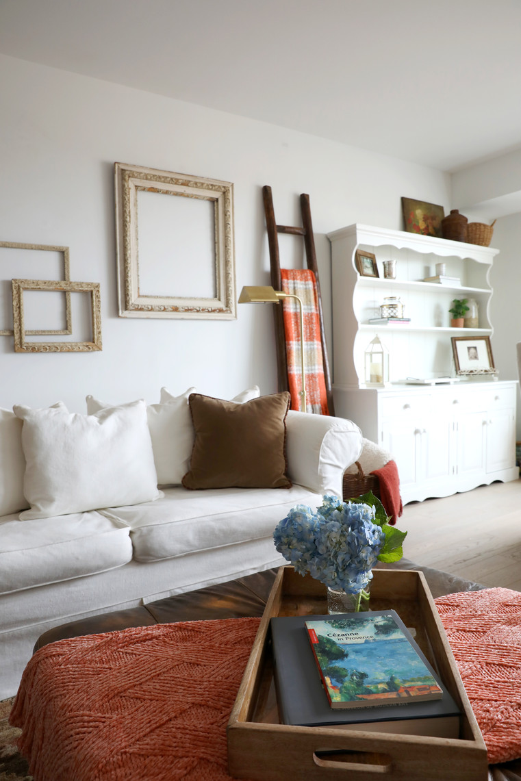Slip-covered sofa, re-painted buffet and