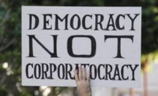 Democracy-Not-Corporatocracy-300x140.jpe