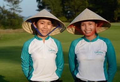 Golf caddies in Vietnam