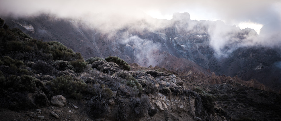 Clouds filtering between the volcanic walls of Teide's plateau.