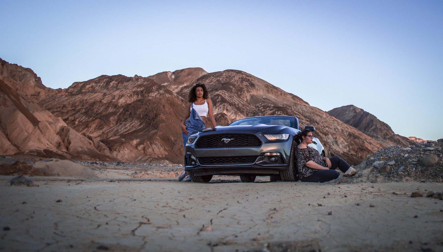 Two girls and their Mustang in Badwater, Death Valley, California.