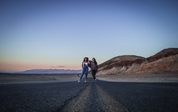 Two girls on the road in Badwater, Death Valley, California