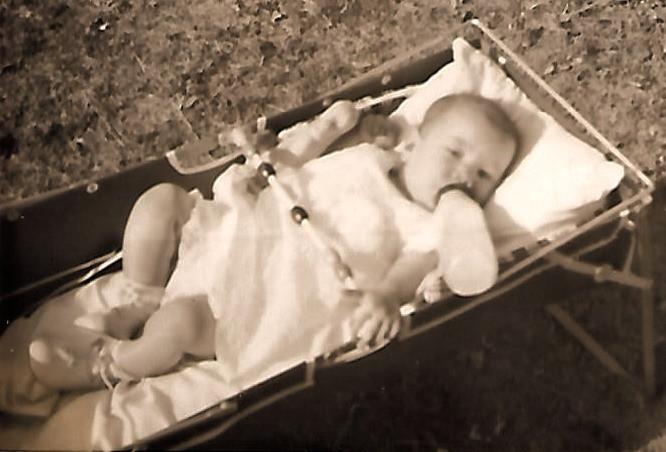 Infant in Car Bed 1952  Bottle propped