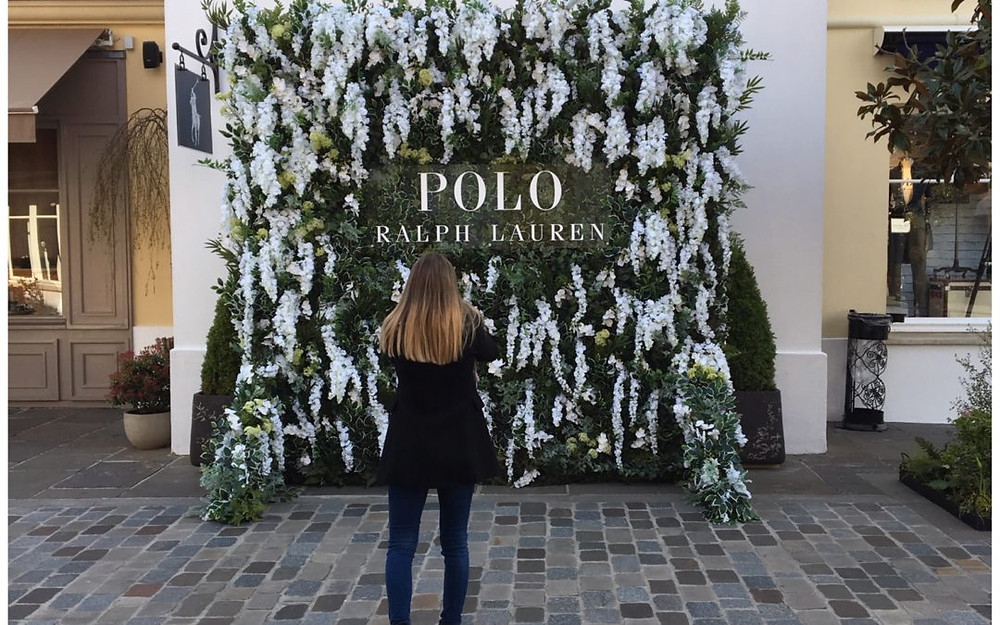A photo of a wall of flowers for Ralph Lauren