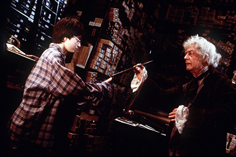 Photo of Mr Ollivander and Harry Potter in the wand shop