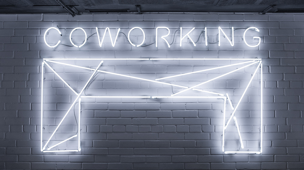 neon sign saying Coworking