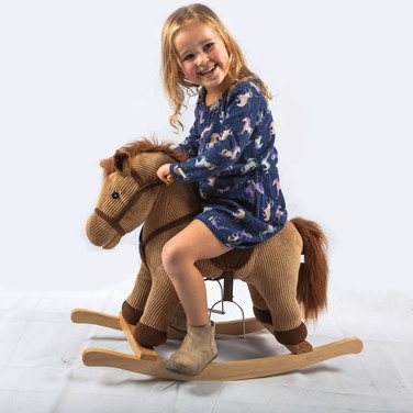 young girl on rocky horse