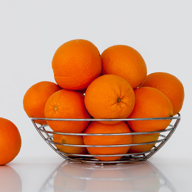 Oranges on white bench