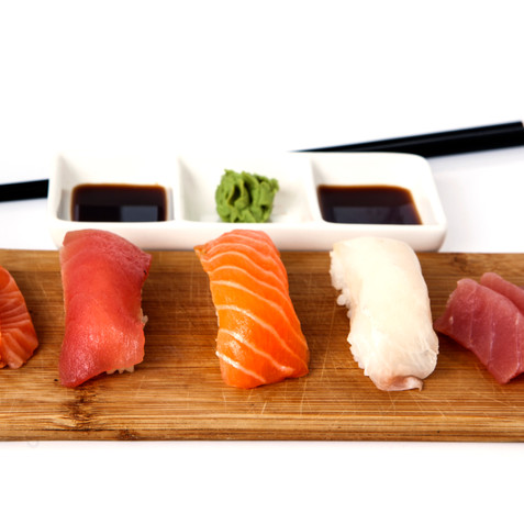 Sushi on a wooden plate