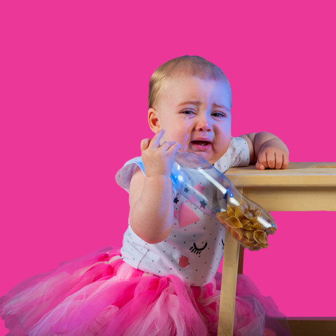 baby girl crying in pink