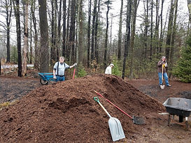 Mulch pile at entry.jpg
