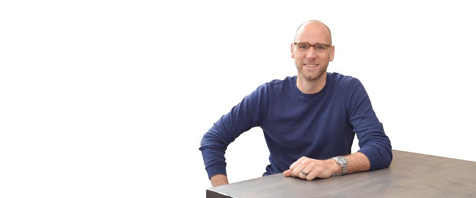 Photo of Joe Bukartek sitting at table