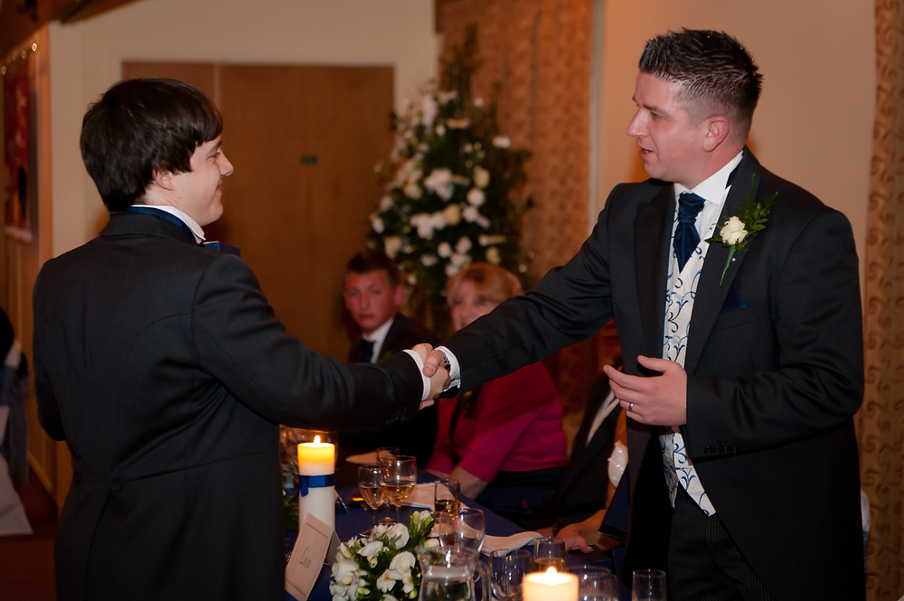 Groom thanking an Usher