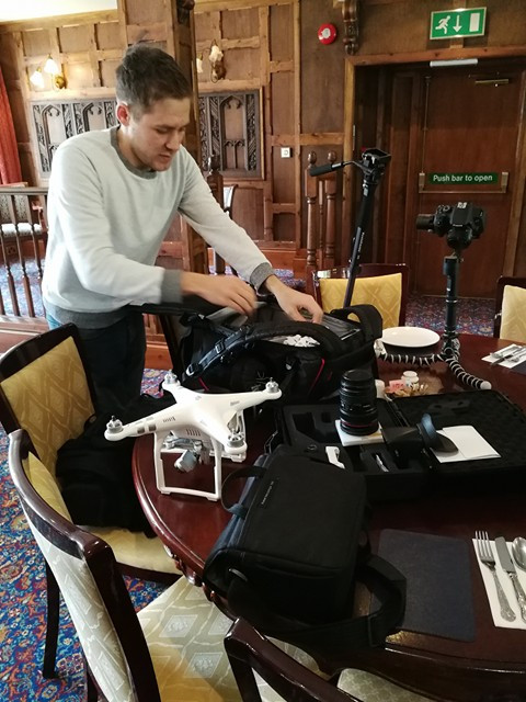 Videographer preparing his equipment